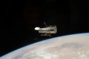 Hubble telescope orbiting Earth [credit: NASA]