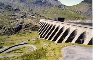 Upper reservoir (Llyn Stwlan) and dam of the Ffestiniog Pumped Storage Scheme in north Wales   [credit: Arpingstone/English Wikipedia]