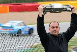 Gal Fridman, co-founder of Aquarius Engines, with the firm's single-piston car engine [image credit: phys.org / Aquarius]